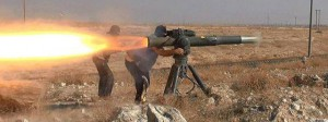 "In this picture released on June 26, 2015, by a website of Islamic State militants, Islamic State militants fire an anti-tank missile in Hassakeh, northeast Syria. Andreas Krieg, a professor at King's College London who embedded with Iraqi Kurdish fighters in the fall of 2014, says IS local commanders are given leeway to operate as they see fit. They ""have overall orders on strategy and are expected to come up with the most efficient ways of adapting it,"" he said. (Militant website via AP)"